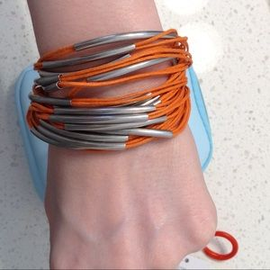 metal and orange rope bracelet